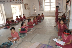A local classroom - no chairs or tables, but it's all incredibly clean and neat.